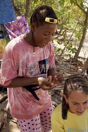 women braiding young girls hair mayreau