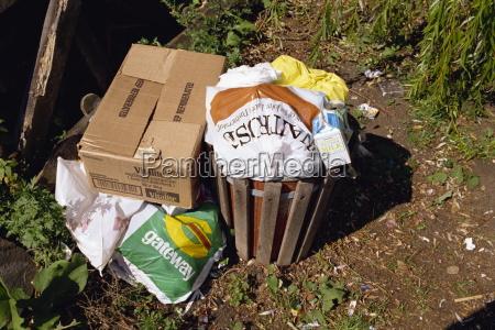 overflowing rubbish bin england united kingdom