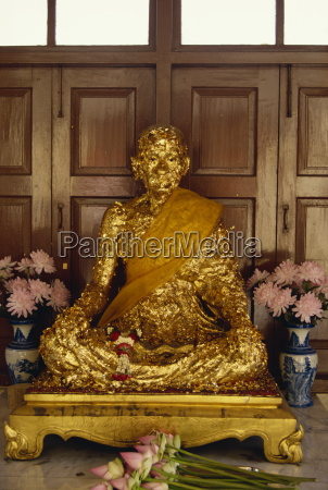statue covered in gold leaf in