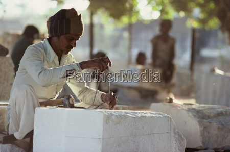 stone mason carving marble for the