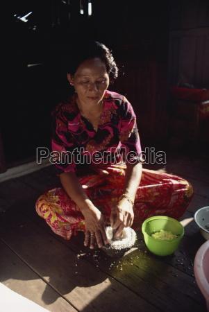 housewife making coconut milk northern malaysia