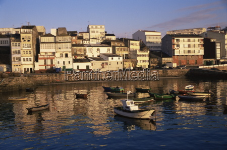 town across fishing boat harbour finisterre