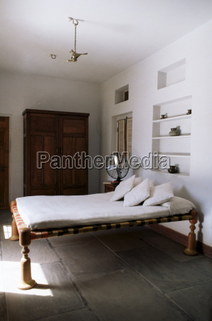 bedroom with traditional low slung bed