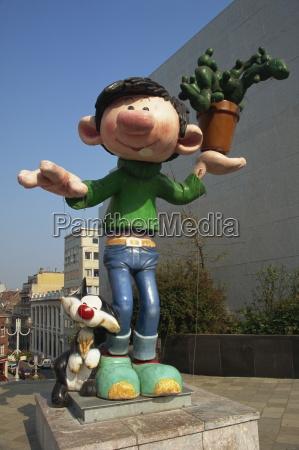 cartoon sculpture near museum of moving
