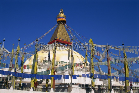 prayer flags around the dome of