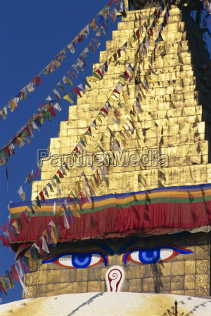buddhas eyes on gold leaf spire