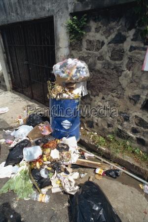 overflowing trash can grenada west indies