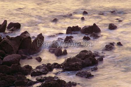 sea breaking against rocks on the