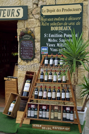 display of wine bottles outside a
