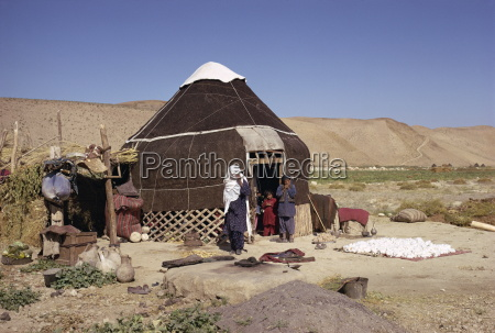 uzbeki family outside yurt near maymana