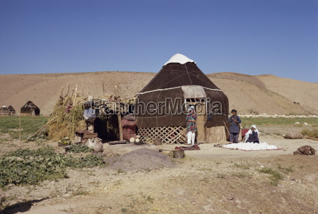 uzbeki tribespeople outside yurt near maymana