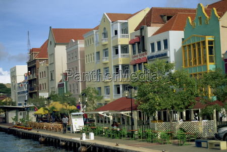 waterfront buildings with outdoor cafes and