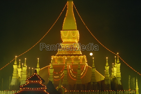 lights illuminate the great stupa of