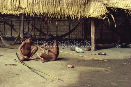 yanomami indian children making arrows brazil