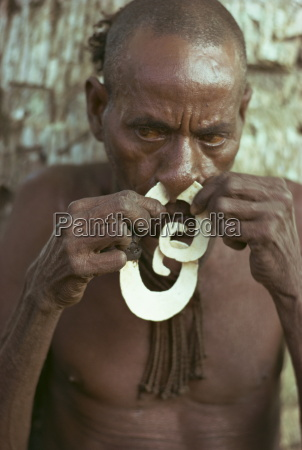 portrait of an elderly asmat man