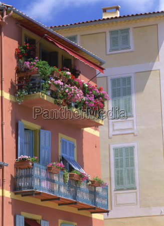 balconies with blue wrought iron and