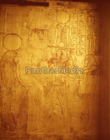 detail of the king wearing osiris