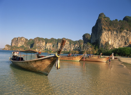 long tail boats moored at railay