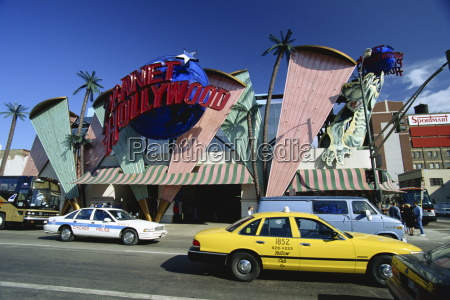 planet hollywood restaurant sign and passing
