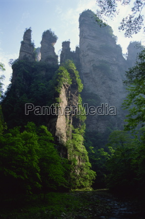 the spectacular limestone outcrops and forested