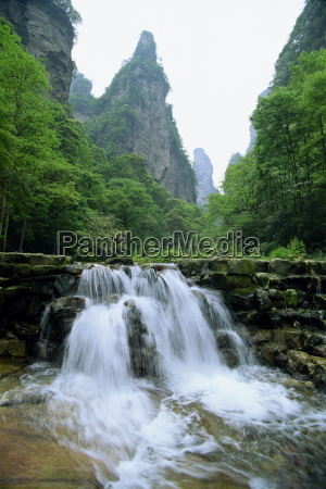 small waterfall in spectacular limestone outcrops