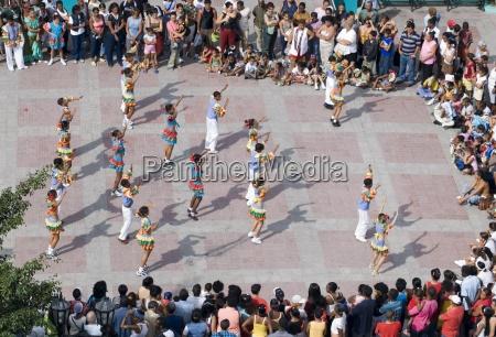 school kids in fancy costumes dancing