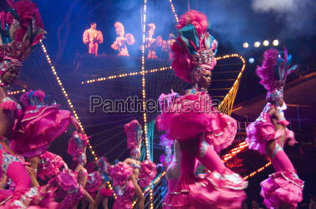 dancing girls in elaborate pink feather