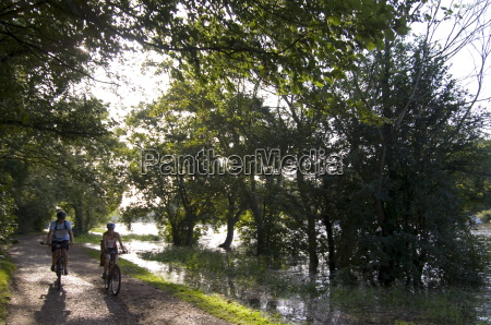 cyclists on the towpath of the