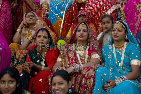 women wearing colourful saris at the