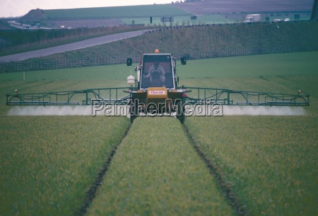 spraying pesticides on crops in fields