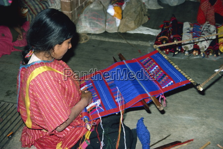 indian woman weaving on a small