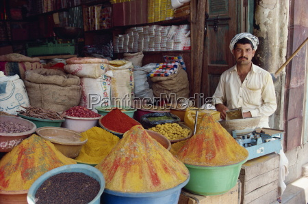 a man selling spices in his