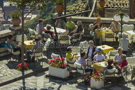 people alfresco on cafe terrace in