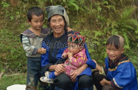 shui woman with children guizhou china