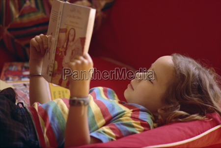 eight year old girl reading book