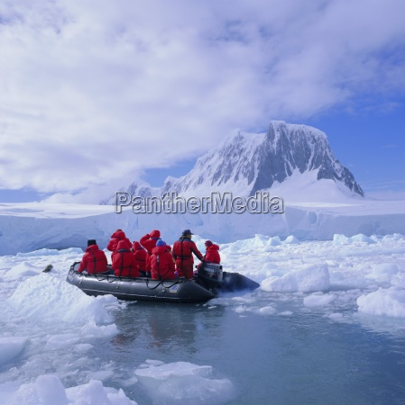 tourists ice cruising in rigid inflatable