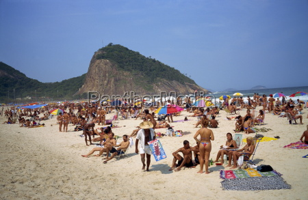crowds of people sunbathing on copacabana