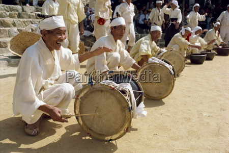 men beating drums during the traditional