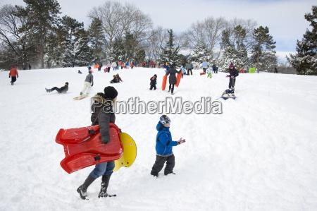 people sledding in central park after