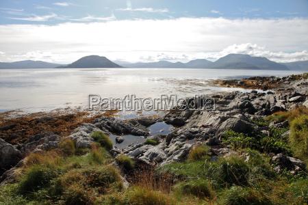 sunlit rocks and foreshore helgoy kvalsund