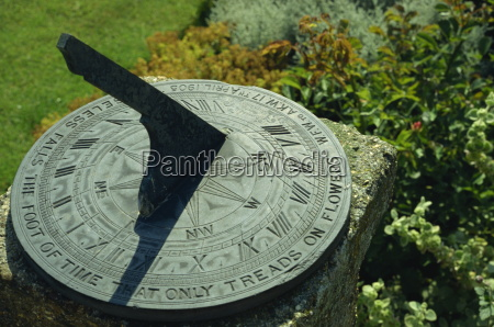 sundial on plate of slate inscribed