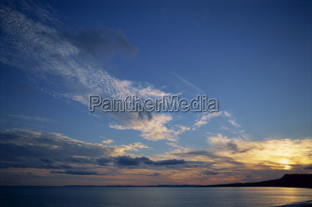 tranquil sky with clouds at sunset
