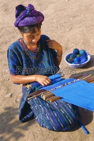 girl weaving traditional huipil santa caterina