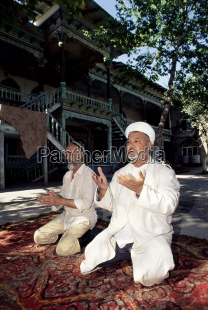 imam and assistant praying central mosque