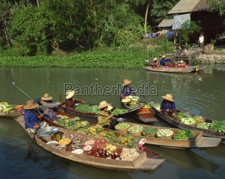 women in straw hats in boats