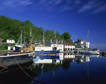 tranquil scene of boats reflected in