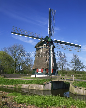 canal and thatched windmill at edam