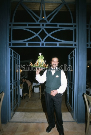 waiter with signature salad at fakhr