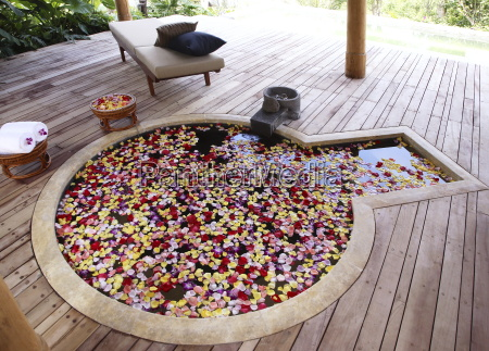 hot spring pool with flowers at