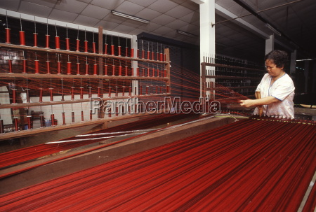 stretching silk at jim thomson factory